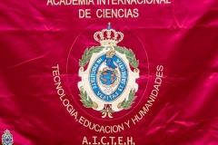 Escudo de la Academia Internacional de la Ciencias, Tecnología, Educación y Humanidades.